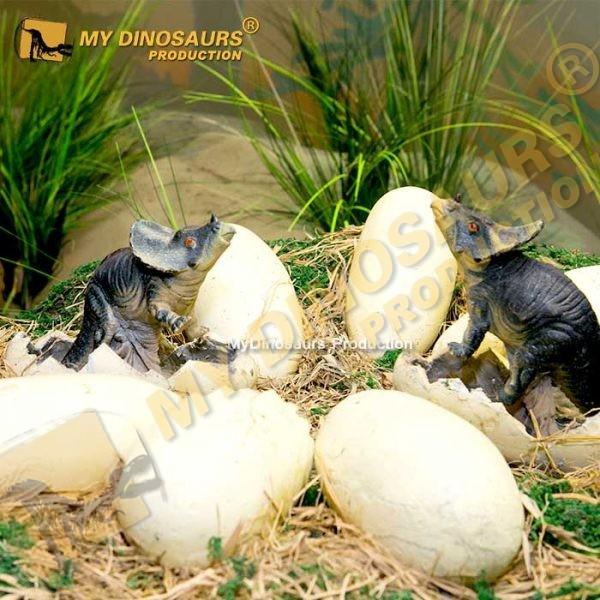 Animatronic baby dinosaur in nest