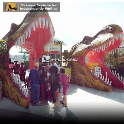 Dinosaur mouth entrance statue