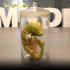 Baby dino in glass jar 1