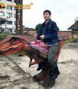 Riding on Dinosaur Costume 1