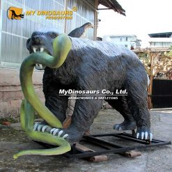 Honey Badger and snake statue